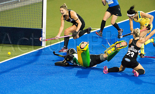 09.04.2016. Hastings, New Zealand.  New Zealand's Charlotte Harrison pushes the ball past the Australia keeper to score. NZL Black Sticks Women versus  Australia. Semi final, Festival of Hockey, Unison Hockey turf, Hastings, New Zealand. Saturday, 09 April, 2016.