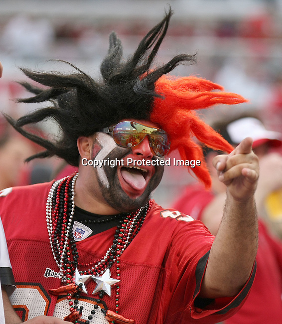 A Tampa Bay Buccaneer's fan enjoys the win against the Kansas City Chiefs. The Buccaneers defeated the Chiefs  20-15 during an NFL preseason game Saturday, Aug. 21, 2010 in Tampa,Fla. (AP Photo/Margaret Bowles).