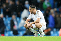 Neil Taylor looks dejected at the end of the Barclays Premier League Match between Manchester City and Swansea City played at the Etihad Stadium, Manchester on 12th December 2015
