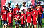 "6 September 2009: Cleveland Indians' utilityman Jamey Carroll poses with kids in the ""Kick-It"" program designed to unite communities in the fight against pediatric cancer. Carroll played kickball with the kids on the field after a game against the Minnesota Twins at Progressive Field in Cleveland, Ohio. The Indians defeated the Twins 3-1 to take the rubber match of their three-game weekend series. Mandatory Credit: Ed Wolfstein Photo"