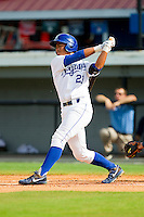 Alfredo Escalera-Maldonado (21) of the Burlington Royals follows through on his swing against the Princeton Rays at Burlington Athletic Park on July 5, 2013 in Burlington, North Carolina.  The Royals defeated the Rays 5-1 in game one of a doubleheader.  (Brian Westerholt/Four Seam Images)