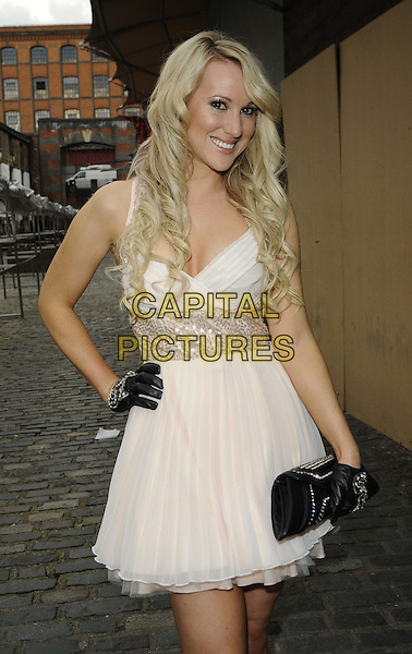 Rebecca Ferdinando.The Charity Gala Dinner in aid of the Ben Kinsella Trust, Gilgamesh Restaurant, London, England..June 25th, 2012.full length black dress white gloves clutch bag hand on hip.CAP/CAN.©Can Nguyen/Capital Pictures.
