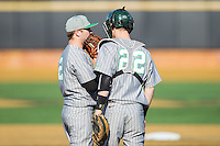 Marshall Thundering Herd catcher Matt Reed (22) had a talk on the mound with relief pitcher Sam Hunter (2) during the game against the Georgetown Hoyas at Wake Forest Baseball Park on February 15, 2014 in Winston-Salem, North Carolina.  The Thundering Herd defeated the Hoyas 5-1.  (Brian Westerholt/Four Seam Images)