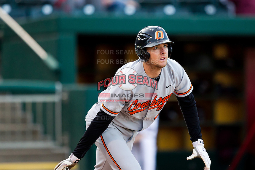 Gabe Weidenaar (44) of the Oklahoma State Cowboys follows through his swing during a game against the Missouri State Bears at Hammons Field on March 6, 2012 in Springfield, Missouri. (David Welker / Four Seam Images)