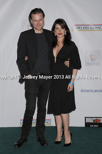 SANTA MONICA, CA - FEBRUARY 21: Colin Devlin and Sonya Macari  arrive at The US-Ireland Alliance Pre-Academy Awards Gala at Bad Robot on February 21, 2013 in Santa Monica, California.