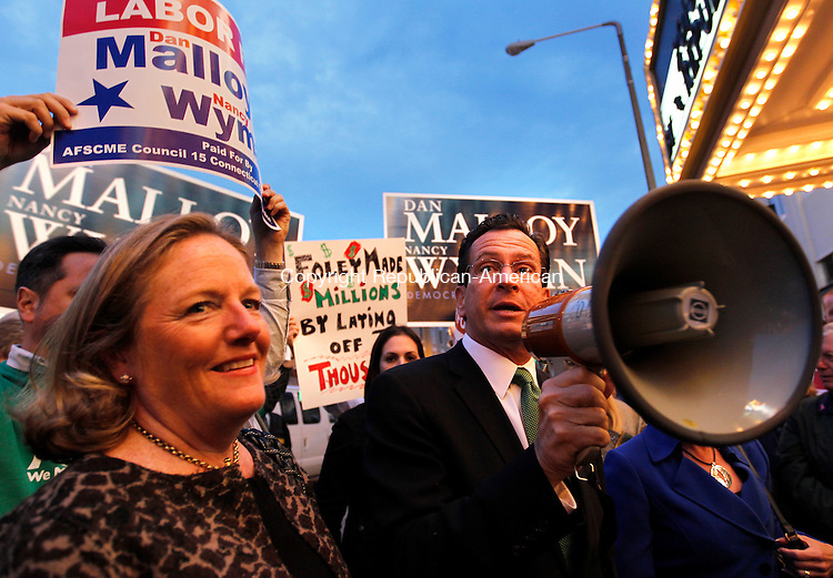 Torrington, CT- 25, October 2010-102510CM02 Democratic Governor candidate Dan Malloy, fires up supporters in downtown Torrington Monday night before a gubernatorial debate against Republican challenger, Tom Foley.   Christopher Massa Republican-American