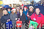 Castleisland traders get in to the Christmas Spirit from left: Sheila Costello, Eileen Doran, Norma Reidy, Dianne Healy, Aileen Lynch, Bill Costello, Larraine Griffin, Shiela Murphy and John Power.