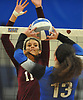 Amanda DeWitt #11 of Whitman left, defends against a hit by Amanda Goldstein #13 of Centereach during a non-league varsity girls volleyball match at New York Institute of Technology in Old Westbury on Wednesday, Sept. 20, 2017. Whitman rallied from a two-set deficit to win 21-25, 16-25, 25-16, 25-22, 25-19.