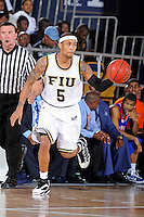 12 November 2010:  FIU's Martavis Kee (5) handles the ball in the second half as the FIU Golden Panthers defeated the Florida Memorial Lions, 89-73, at the U.S. Century Bank Arena in Miami, Florida.