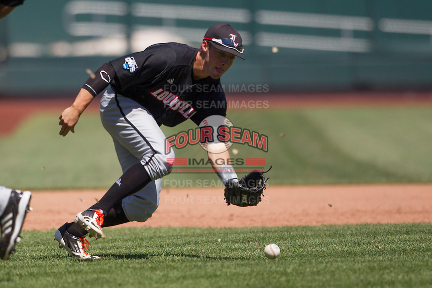 Louisville third baseman Ty Young (30) fields a ground ball against the Oregon State Beavers during Game 5 of the 2013 Men's College World Series on June 17, 2013 at TD Ameritrade Park in Omaha, Nebraska. The Beavers defeated Cardinals 11-4, eliminating Louisville from the tournament. (Andrew Woolley/Four Seam Images)
