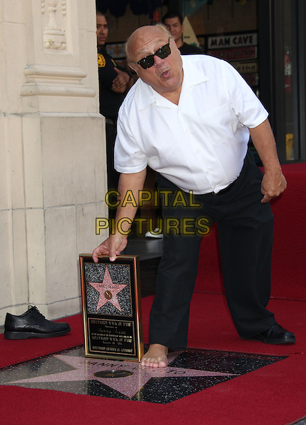 Danny DeVito .Danny DeVito Honored On The Hollywood Walk Of Fame Held On Hollywood Blvd., Hollywood, California, USA..August 18th, 2011.full length white shirt sunglasses shades black trousers plaque bending leaning mouth open.CAP/ADM/RE.©Russ Elliot/AdMedia/Capital Pictures.