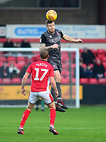 Lincoln City's Michael O'Connor heads clear under pressure from Crewe Alexandra's Paul Green<br /> <br /> Photographer Andrew Vaughan/CameraSport<br /> <br /> The EFL Sky Bet League Two - Crewe Alexandra v Lincoln City - Wednesday 26th December 2018 - Alexandra Stadium - Crewe<br /> <br /> World Copyright &copy; 2018 CameraSport. All rights reserved. 43 Linden Ave. Countesthorpe. Leicester. England. LE8 5PG - Tel: +44 (0) 116 277 4147 - admin@camerasport.com - www.camerasport.com