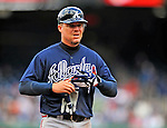 2 April 2011: Atlanta Braves third baseman Chipper Jones returns to the dugout during a game against the Washington Nationals at Nationals Park in Washington, District of Columbia. The Nationals defeated the Braves 6-3 in the second game of their season opening series. Mandatory Credit: Ed Wolfstein Photo