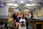 The volleyball team poses with their training room decorations at Marymount University in Arlington, Vir., on Friday, Sept. 28, 2012. .Photo by Cathleen Allison