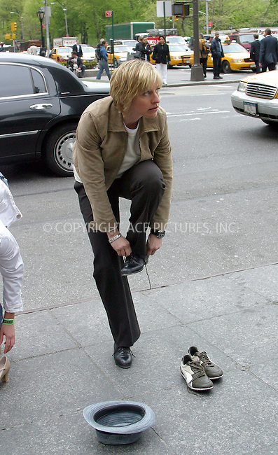 Ellen DeGeneres filming promotional video for her new NBC Networks' talk show on Fifth Avenue in Manhattan. During the taping, Ellen decided to make some extra cash and put on her tapping shoes. Later she was seen tap dancing for the crowd of pedestrians. People were extra generous and Ellen's hat filled up pretty quick. New York, May 5, 2003. Please byline: Alecsey Boldeskul/NY Photo Press.   ..*PAY-PER-USE*      ....NY Photo Press:  ..phone (646) 267-6913;   ..e-mail: info@nyphotopress.com....Elen........