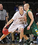 SIOUX FALLS, SD - MARCH 6:  Matt O'Leary #15 of IUPUI leans into defender A.J. Jacobson #21 of North Dakota State in the 2016 Summit League Tournament. (Photo by Dick Carlson/Inertia)