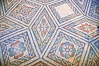 Detail of the geometric  Roman mosaics at the Villa Romana del Casale which containis the richest, largest and most complex collection of Roman mosaics in the world, circa the first quarter of the 4th century AD. Sicily, Italy. A UNESCO World Heritage Site.