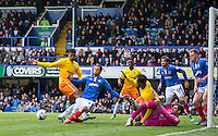 Christian Burgess of Portsmouth beats Rowan Liburd (Loanee from Reading) of Wycombe Wanderers to the ball during the Sky Bet League 2 match between Portsmouth and Wycombe Wanderers at Fratton Park, Portsmouth, England on 23 April 2016. Photo by Andy Rowland.