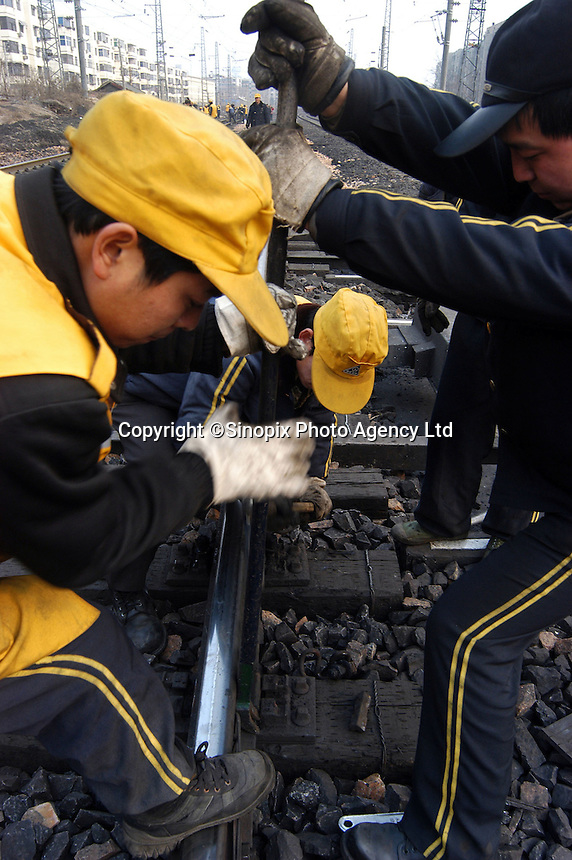Workers at the railway restoration project in Zhengzhou, China.
