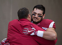 Hawgs Illustrated/BEN GOFF <br /> Bret Bielema, Arkansas head coach, hugs offensive lineman Paul Ramirez during recognition of senior players before the game against Missouri Friday, Nov. 24, 2017, at Reynolds Razorback Stadium in Fayetteville.
