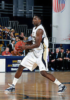 Florida International University guard Tola Akomolafe (33) plays against Coastal Carolina University.  FIU won the game 64-62 on November 26, 2011 at Miami, Florida. .