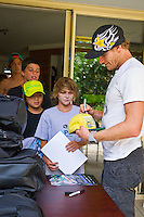 Casuarina Beach,New South Wales, Australia. Tuesday 10 2012. Bede Durbidge (AUS) siging autographs for the grommets who attended his camp.  Surfing Australia's High Performance Centre on the Tweed Coast ran a surfing training camp for promising young surfers to hone their skills. The Bede Durbidge Surf Camp was the first camp for 2012. Bede Durbidge  (AUS) took the members of the camp for a surf session at Casuarina Beach before answering questions form the grommets and discussing video footage of the surf session.. Photo: joliphotos.com