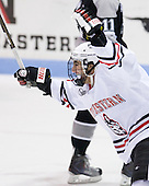 Rob Dongara (Northeastern - 39) celebrates Wade MacLeod's goal which opened scoring in the game at the 14:43 mark of the first period.  Dongara earned the primary assist. - The Northeastern University Huskies defeated the visiting Providence College Friars 5-0 on Saturday, November 20, 2010, at Matthews Arena in Boston, Massachusetts.