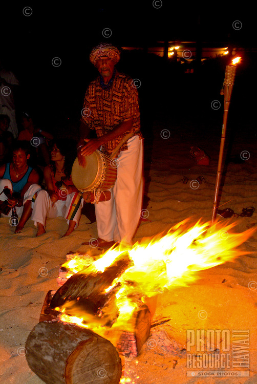 Evening beach party with bonfire and Djembe drumming