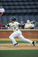 Logan Harvey (15) of the Wake Forest Demon Deacons follows through on his swing against the Miami Hurricanes at David F. Couch Ballpark on May 11, 2019 in  Winston-Salem, North Carolina. The Hurricanes defeated the Demon Deacons 8-4. (Brian Westerholt/Four Seam Images)