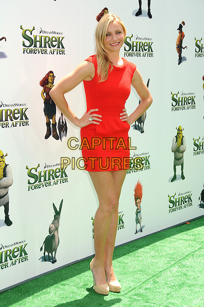 "CAMERON DIAZ.Attending the ""Shrek Forever After"" Los Angeles Film Premiere held at the Gibson Amphitheatre, Universal City, California, USA, 16th May 2010..arrivals full length red dress mini sleeveless hands on hips beige nude platform shoes ring .CAP/ADM/BP.©Byron Purvis/AdMedia/Capital Pictures."