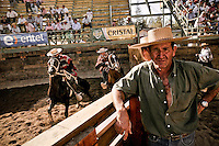 Huasos during a  rodeo in  Los Andes city. This sports is very popular in rural areas of the country.A team called  collera is formed by 2 riders called huasos  with horses that try to trap a  calf.