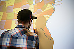 Ethan Buckner works on a map of the US in preparation for Powershift 2013 in PIttsburgh, PA. (Photo by: Robert van Waarden)