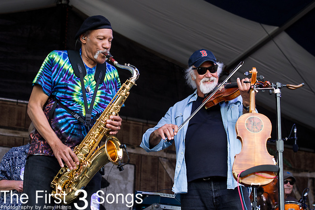 Charles Neville and Michael Doucet of BeauSoleil performs during the New Orleans Jazz & Heritage Festival in New Orleans, LA.