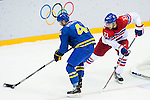 (L) Gustav Nyquist of Sweden being followed by (R) Zbynek Michalek of Czech Republic during the match between Sweden vs Czech Republic during their Men's Ice Hockey Preliminary Round Group C game on day five of the 2014 Sochi Olympic Winter Games at Bolshoy Ice Dome on February 12, 2014 in Sochi, Russia. Photo by Victor Fraile / Power Sport Images