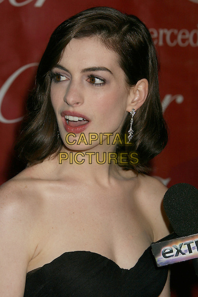 ANNE HATHAWAY.20th Annual Palm Springs International Film Festival Awards Gala held at the Palm Springs Convention Center, Palm Springs, California, USA..January 6th, 2009.headshot portrait mouth open strapless .CAP/ADM/MJT.© MJT/AdMedia/Capital Pictures.