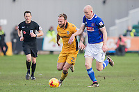 Sean Rigg of Newport County holds off Jason Kennedy of Carlisle during the Sky Bet League 2 match between Newport County and Carlisle United at Rodney Parade, Newport, Wales on 12 November 2016. Photo by Mark  Hawkins.