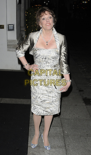 ESTHER RANTZEN .At the Inspirational Women Of The Year Awards, Marriott Hotel, Grosvenor Square, London, England, UK, November 23rd 2010..full length gold shrug silk satin print cream beige dress shoes blue clutch bag  hand on hip .CAP/CAN.©Can Nguyen/Capital Pictures.