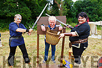 Christy O'Mahoney from Tralee putting his head on the block as Inga J and Mary Jacob of Wildboar Warriors decide what to do at the Kilflynn Fairy Festival on Sunday.