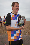 © Joel Goodman - 07973 332324 . 23/09/2013 . Brighton , UK . ALASTAIR CAMPBELL with his book . Alastair Campbell joins runners along Brighton Beach to raise awareness for Alcohol Concern . Day 2 of the Labour Party 's annual conference in Brighton . Photo credit : Joel Goodman