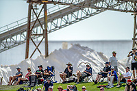 Fans watch from the embankment with salt mountains in the background during day two of the international cricket 1st test match between NZ Black Caps and England at Bay Oval in Mount Maunganui, New Zealand on Friday, 22 November 2019. Photo: Dave Lintott / lintottphoto.co.nz