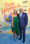 """Kelly Devine and Christopher Ashley attending the Broadway Opening Night Performance of  """"Escape To Margaritaville"""" at The Marquis Theatre on March 15, 2018 in New York City."""