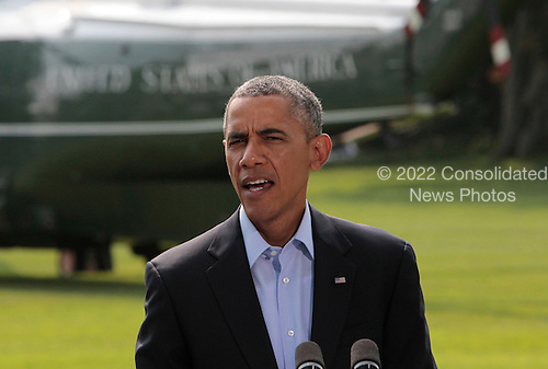 United States President Barack Obama makes a statement concerning the involvement of the U.S. military in Iraq from the South Lawn of the White House in Washington, D.C.  before departing for a vacation on Martha's Vineyard on August 9, 2014.  <br /> Credit: Dennis Brack / Pool via CNP