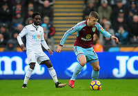 Swansea City's Nathan Dyer vies for possession with Burnley's Johann Gudmundsson<br /> <br /> Photographer Ashley Crowden/CameraSport<br /> <br /> The Premier League - Swansea City v Burnley - Saturday 10th February 2018 - Liberty Stadium - Swansea<br /> <br /> World Copyright &copy; 2018 CameraSport. All rights reserved. 43 Linden Ave. Countesthorpe. Leicester. England. LE8 5PG - Tel: +44 (0) 116 277 4147 - admin@camerasport.com - www.camerasport.com