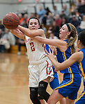 WINSTED,  CT-021119JS19- Northwestern's Francesca DeSanti (2) tries to get off a pass while being defended by Housatonic's Caroline Hurlburt (10) during their Berkshire League game Monday at Northwestern. <br /> Jim Shannon Republican American