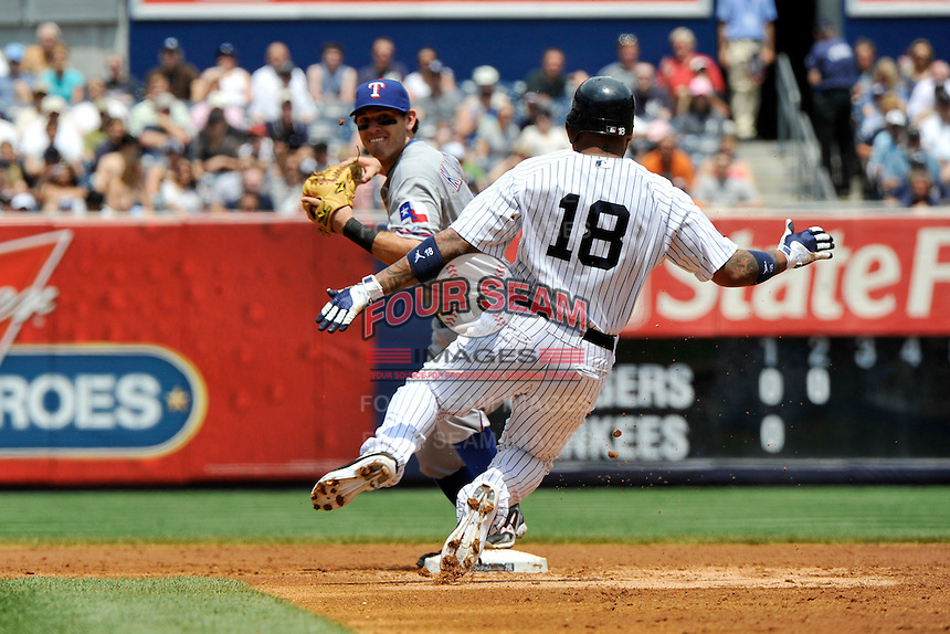 Texas Rangers second baseman  Ian Kinsler #5 during a game against the New York Yankees at Yankee Stadium on June 16, 2011 in Bronx, NY.  Yankees defeated Rangers 3-2.  Tomasso DeRosa/Four Seam Images