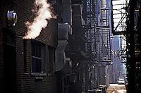 Narrow street surrounded by urban brick buildings, Boston, Massachusetts, USA.