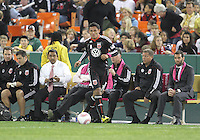 Andy Najar #14 of D.C. United in front of the D.C. bench during an MLS match against Toronto FC that was the final appearance of D.C. United's Jaime Moreno at RFK Stadium, in Washington D.C. on October 23, 2010. Toronto won 3-2.