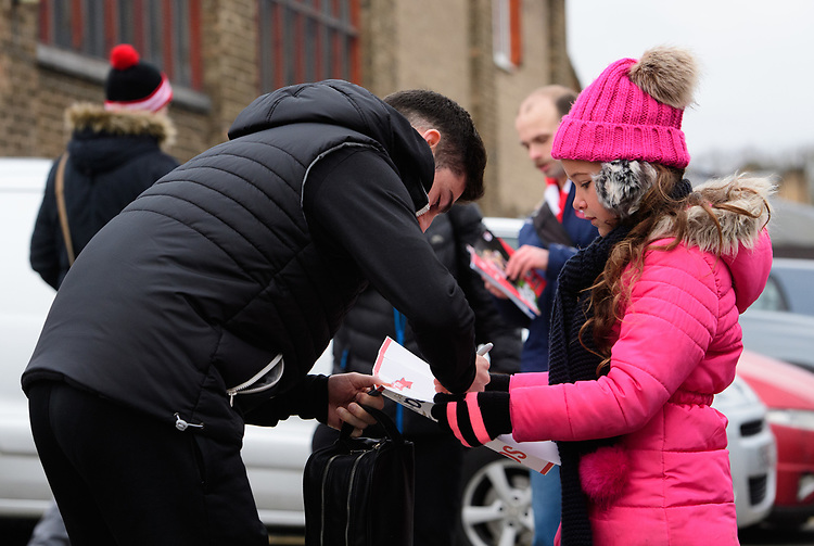 Lincoln City's Tom Pett signs autographs for fans after arriving at the ground<br /> <br /> Photographer Chris Vaughan/CameraSport<br /> <br /> The EFL Sky Bet League Two - Lincoln City v Grimsby Town - Saturday 19 January 2019 - Sincil Bank - Lincoln<br /> <br /> World Copyright &copy; 2019 CameraSport. All rights reserved. 43 Linden Ave. Countesthorpe. Leicester. England. LE8 5PG - Tel: +44 (0) 116 277 4147 - admin@camerasport.com - www.camerasport.com