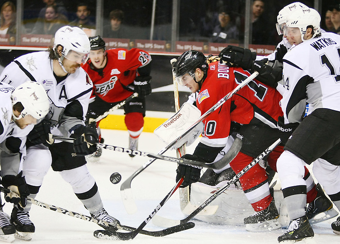 Abbotsford Heat's Lance Bouma, middle, chases the puck as San Antonio Rampage's Matt Watkins, right, Bracken Kearns, left, and Ryan Hollweg defend during the third period of an AHL hockey game, Wednesday, Jan. 26, 2011, at the AT&T Center in San Antonio. San Antonio won 4-2. (Darren Abate/pressphotointl.com)