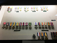 BNPS.co.uk (01202 558833)<br /> Pic: SusanBond/BNPS<br /> <br /> The medals have subsequently been removed from the display case.<br /> <br /> Military museum in hot water over missing medals..<br /> <br /> A woman whose father and grandfather donated their highly-valuable gallantry medals to an army museum is furious they have disappeared having been suspiciously substituted for duplicates.<br /> <br /> Susan Bond, whose husband Richard is a retired crown court judge, discovered the two Military Cross groups at the The Royal Green Jackets Museum are not the ones bequeathed to them after one set appeared on the open market.<br /> <br /> Mrs Bond confronted the trustees at the museum, whose former Colonel-in-Chief was the Queen, but the 70-year-old has been left dismayed at their 'indifferent' response at the loss which they have been unable to properly explain.<br /> <br /> The owners - the museum based in Winchester, Hants - said they were satisfied that no criminal activity had taken place and the police investigation came to nothing.